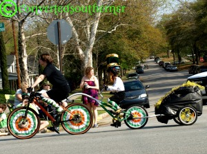 oh yes.... that is a costumed kid on a tandem bike.