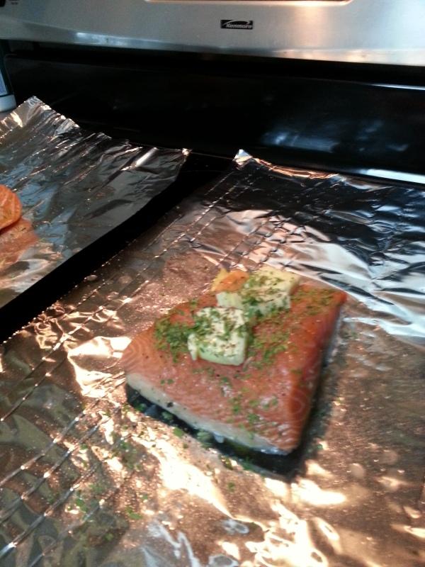 Lemon on the bottom, salmon, tarragon, butter, salt, pepper and lemon juice ready to go on the grill.