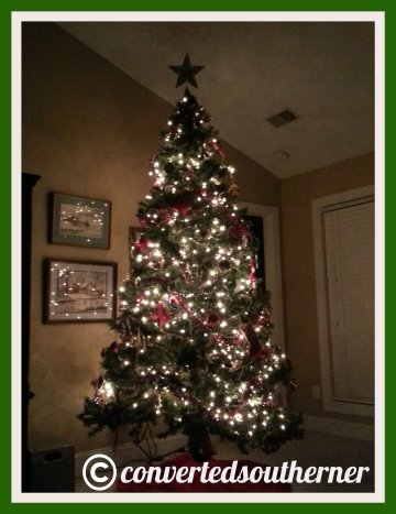 The tree! So much for the ease of the pre-lit tree... I had to make a Target run to buy lights to add to it this year!