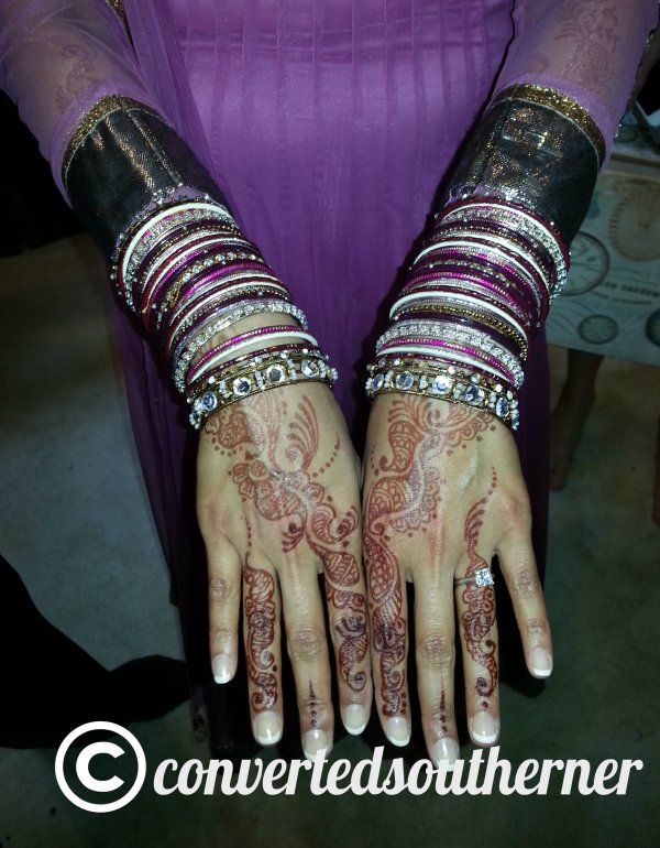 Bridal henna on hands, and you can see it going up to her elbows.