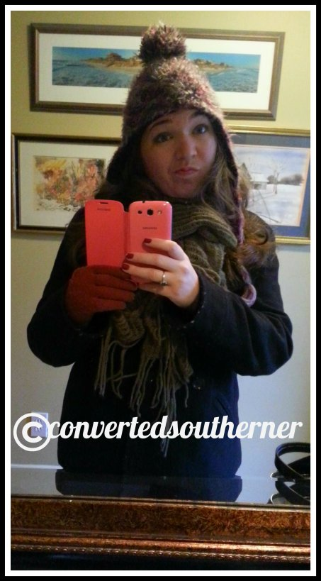 Bundled up in my warmest coat, hat gloves and scarf. I was not amused with the cold weather!