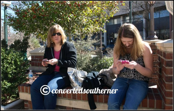 Rach and Gail playing on their phones while we wait for our table at Tupelo Honey in Asheville