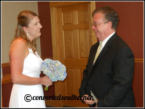 The bride getting advice from her Dad