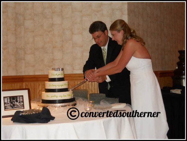 Gail and Puff cutting the cake