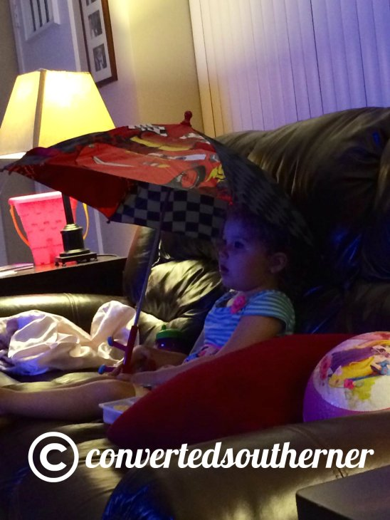 Lili.. Chilling with her umbrella. July 2014. Three year olds are funny.