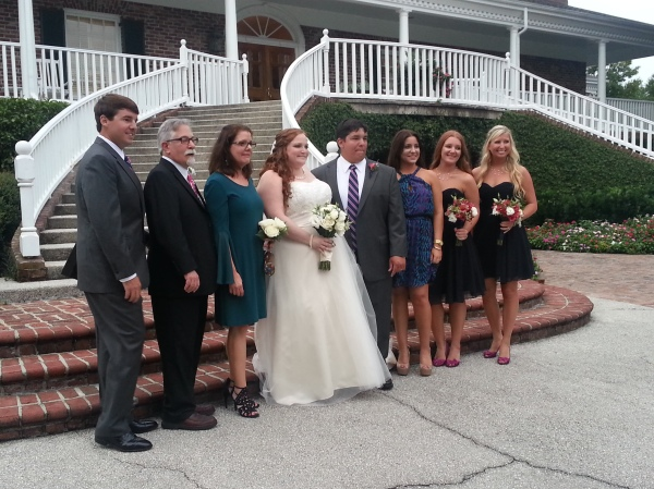 The Bride and groom with his mom, step-dad, sisters, brother and sister-in-law. I already loved Emily, but I loved her a little bit more during all these family pictures... she was issuing directions like a boss- just like I would!