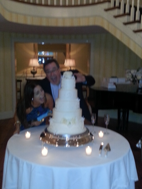 My Dad and Hayden, sister of the groom, goofing off around the cake.