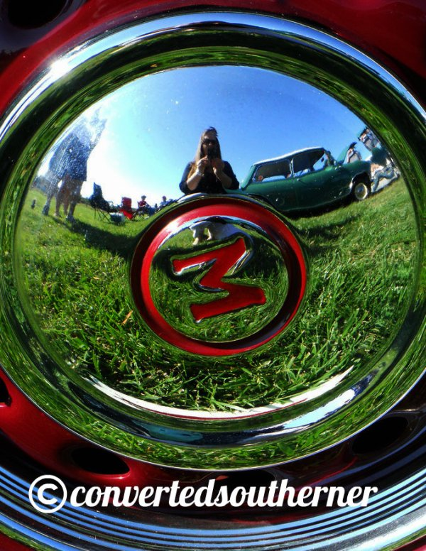 Me, reflected in tire cap, at the European Car Show in 2011.