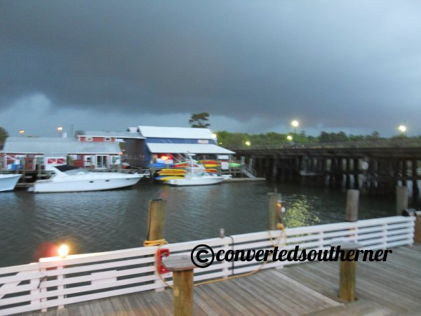 The rehearsal dinner was held at a resturant on Shem Creek, where the bride and groom meet working one summer in college. As you can see it was a about to storm... tradition for a storm at a wedding weekend in our family!