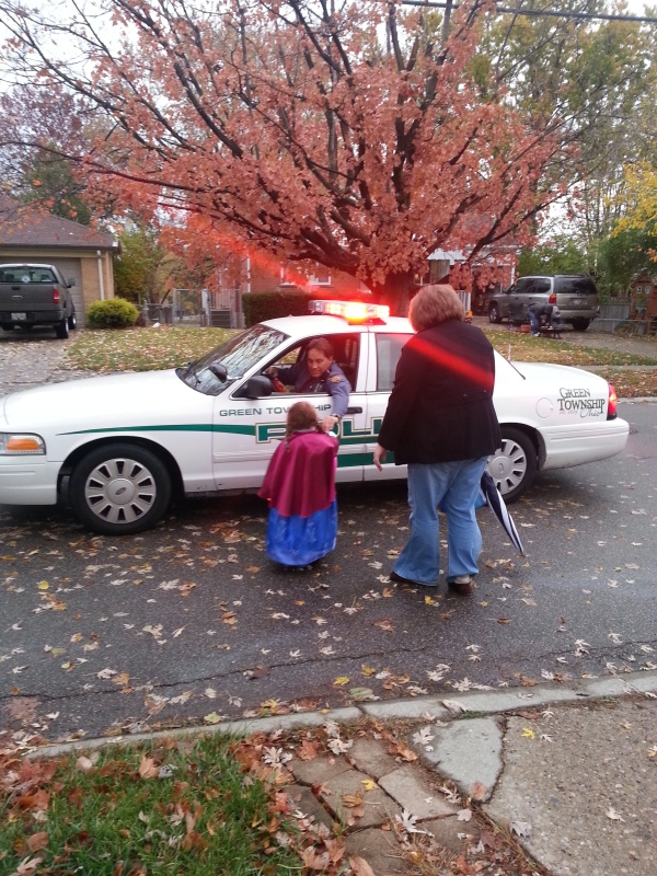 Visiting with a nice police officer who was keeping an eye on the trick or treat activities.